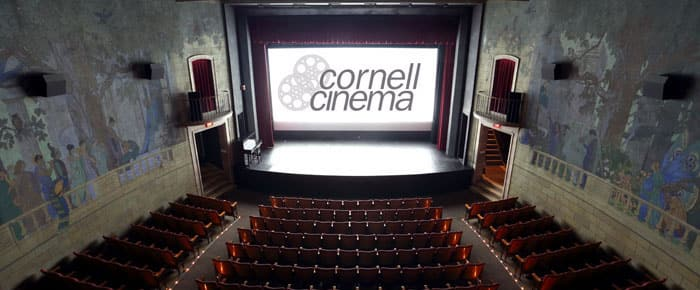 Logo of Cornell Cinema on the screen in the theatre