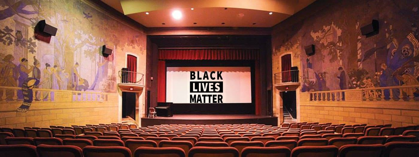 "Photo of Willard Straight Theatre with text ""Black Lives Matter"""